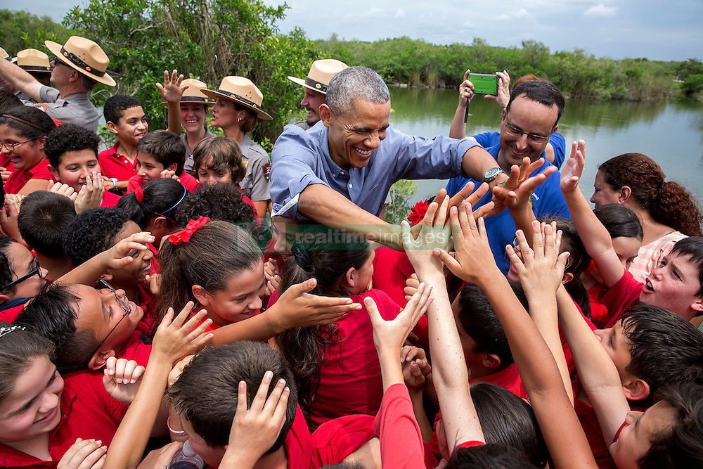 President Barack Obama greets a group of students at Everglades National Park, Fla. on Earth Day, April 22, 2015. (Official White House Photo by Pete Souza)<br /> <br /> This official White House photograph is being made available only for publication by news organizations and/or for personal use printing by the subject(s) of the photograph. The photograph may not be manipulated in any way and may not be used in commercial or political materials, advertisements, emails, products, promotions that in any way suggests approval or endorsement of the President, the First Family, or the White House.