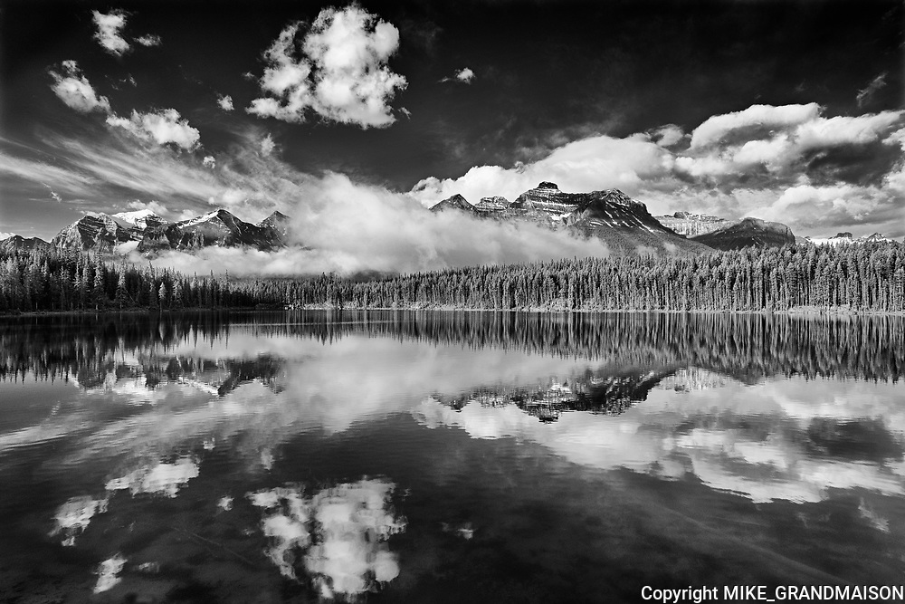 Clouds and Rocky Mountains reflected in Herbert Lake , Banff National Park, Alberta, Canada