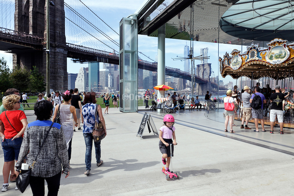 Empire Fulton Ferry park in DUMBO with Jane's carousel and view on downtown Manhattan and the Brooklyn Bridge