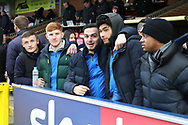 Players watching from the stands during the EFL Sky Bet League 1 match between AFC Wimbledon and Barnsley at the Cherry Red Records Stadium, Kingston, England on 19 January 2019.