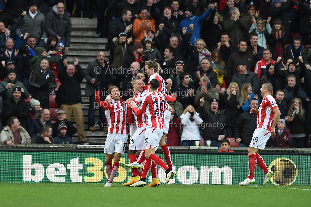 Stoke city players celebrate their sides 1st goal scored by Ryan Shawcross (c). Barclays Premier league match, Stoke city v Manchester Utd at the Britannia Stadium in Stoke on Trent, Staffs on New Years Day , Thursday 1st Jan 2015. pic by Andrew Orchard. Andrew Orchard sports photography.