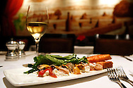 A marinated squid salad with mussels, burrata, Marin Roots farm arugula, roasted gypsy peppers, rosemary sea salt, and tomato bread, at Absinthe Brasserie and Bar on Hayes Street in San Francisco, CA., on Tuesday, Oct. 23, 2007. ..PHOTOGRAPHER: Erin Lubin/Bloomberg News.