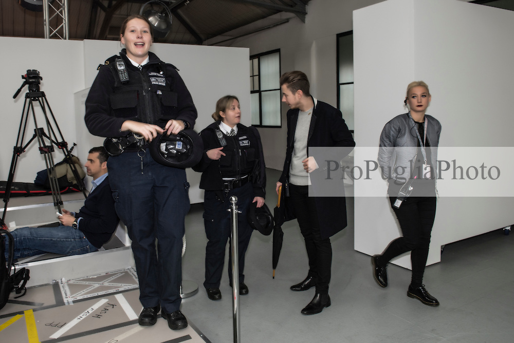 Police Officer taking pictures at London Fashion Week