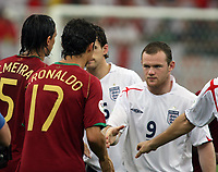 Photo: Chris Ratcliffe.<br /> England v Portugal. Quarter Finals, FIFA World Cup 2006. 01/07/2006.<br /> Wayne Rooney of England shakes hands with Cristiano Ronaldo.