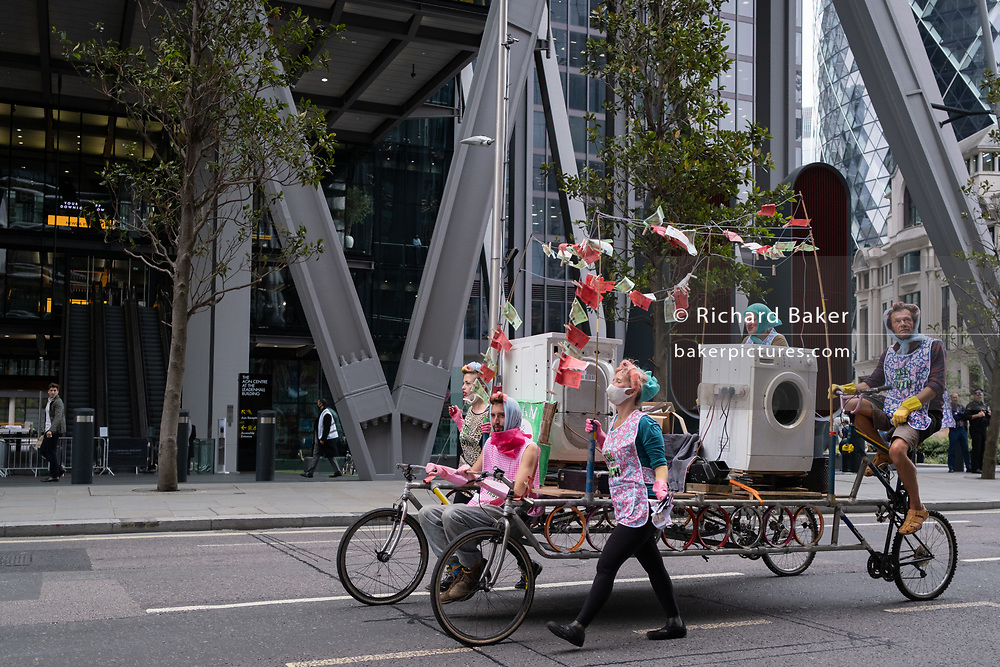 Supporters of Climate Change Extinction Rebelion protest the financial sector's blindness to money laundering and corporate corruption, with their 'Dirty Money Laundering Service', on 9th September 2020, in the City of London, England.