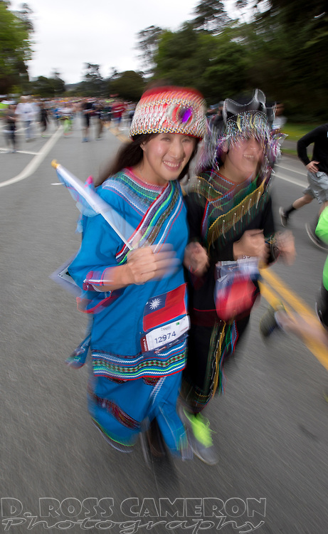 Dressed in traditional Taiwanese garb, Kaier Kao, left, and Lyah Na make their way along Fell Street during the 104th running of the Bay to Breakers 12k, Sunday, May 17, 2015 in San Francisco. Tens of thousands of runners, some clad in costume and some in nothing at all, populated the 7.42-mile route. (D. Ross Cameron/Bay Area News Group)
