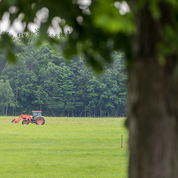 A tractor in a field at Clarke Farm in Epping, New Hampshire.