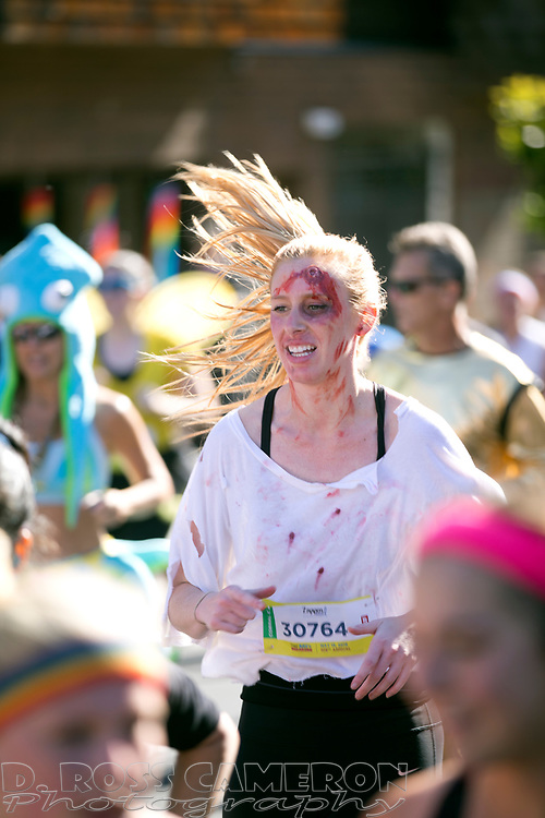 A woman costumed as a zombie jogs along Fell Street during the 105th running of the Bay to Breakers 12k, Sunday, May 15, 2016 in San Francisco. The 7.42-mile race from San Francisco Bay to the Pacific Ocean, which attracts a field of tens of thousands of runners, from elite runners to weekend warriors, some clad in costume and some in nothing at all. (Photo by D. Ross Cameron)