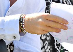 The Duke of Sussex, wearing a bracelet with the word 'justice' as he visits the Justice Desk initiative, at the Nyanga Township, Cape Town, South Africa.