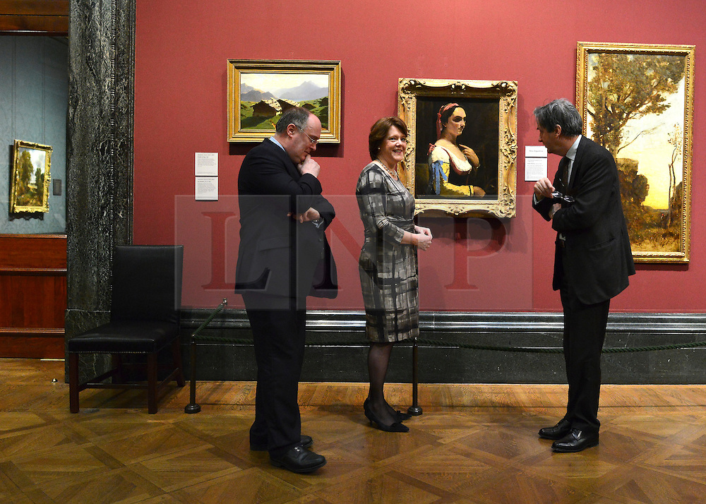 © Licensed to London News Pictures. 04/02/2013. Westminster, UK (L-R) Alan Davey, Chief Executive, Arts Council England, Maria Miller, Culture Secretary and Dr Nicholas Penny became Director of the National Gallery. Culture Secretary Maria Miller unveils A painting by Jean-Baptiste Camille Corot (centre) as she unveils exceptional items accepted in lieu from the estate of Lucian Freud at The National Gallery in central London today 4th February 2013.  Photo credit : Stephen Simpson/LNP