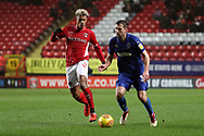 AFC Wimbledon defender Ben Purrington (3) taking on Charlton Athletic attacker Lyle Taylor (9) during the EFL Sky Bet League 1 match between Charlton Athletic and AFC Wimbledon at The Valley, London, England on 15 December 2018.