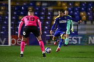 AFC Wimbledon midfielder Cheye Alexander (7) battles for possession withp18\ during the EFL Sky Bet League 1 match between AFC Wimbledon and Peterborough United at Plough Lane, London, United Kingdom on 2 December 2020.