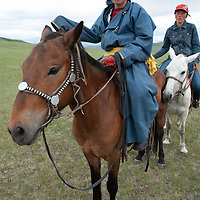 Young nomadic herders on his horses during a naadam festival on a remote pass in Arbulag Sum, near Muren in Hovsgol Aimag, Mongolia.