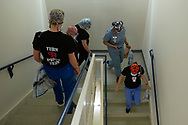 The UMass University Prone Team members, Claire Gritkind, RN, Becky Corbett, RN, Danielle Larson, RN, Zachiah Meeks, RN, and Cilissa Leroux (left to right) make their way down the stairs to reposition a Covid-19 positive patient in an ICU.