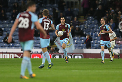 Burnley's Chris Wood runs back with the ball after scoring his side's first goal of the game during the Carabao Cup, third round match at Turf Moor, Burnley.