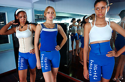 Teenage girls take  a class in in putting on makeup and walking the runway as part of classes given to them in preparation for the Miss Teen Globe Distrito Capital beauty pageant.  Beauty schools are common throughout Venezuela and include runway, makeup, hair, question and answer, and excercise classes.  Fashion and looking good are top priorities in Venezuela, where there is a general culture of beauty.  It is a culture that permeates all walks of life and covers the country like a blanket. Girls enter beauty pageants as toddlers and young women and men get plastic surgery as teens.  Venezuela is a country where thongs and short skirts are the norm, cleavage awaits around every corner and metrosexual men abound.