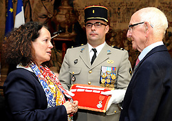 Veteran Roy Clegg, 92, from Staines-upon-Thames, receives the Legion d'honneur, France's highest distinction, from the French Ambassador Sylvie Bermann for his role in liberating France during the Second World War, during a ceremony at the Ambassador's residence in Kensington, London.