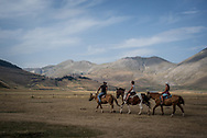 About ten months after an earthquake hit central Italy, tourist are coming back to the area. A group of tourists during a horseback riding lesson in the Castelluccio di Norcia valley.