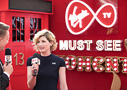 EDITORIAL USE ONLY<br /> Jodie Whittaker spills the beans to Virgin TV's red-carpet host Roman Kemp in Virgin TV's Must-See Moment Lounge at the Virgin TV British Academy Television Awards.