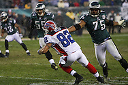 PHILADELPHIA - DECEMBER 30: Juqua Thomas #75 of the Philadelphia Eagles lunges towards ball carrier Josh Reed #82 of the Bills during the game against the Buffalo Bills on December 30, 2007 at Lincoln Financial Field in Philadelphia, Pennsylvania. The Eagles won 17-9.