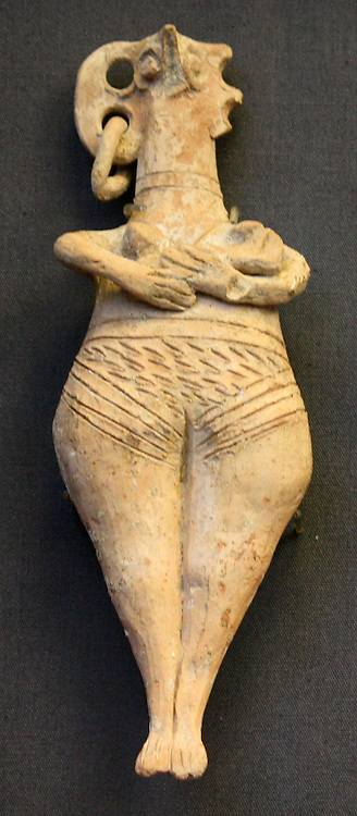 Terracotta female figurine with bird like face and pierced ears. Made in Cyprus 1450-1200 BC. Found in Tomb 93, Enkomi Cyprus. She holds her infant in her arms, it's head next to her left breast