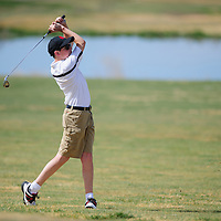 010110       Adron Gardner/Independent<br /> <br /> Grants Pirate J.T. Goodart tees off during the district golf tournament at the Coyote Del Malpais Golf Course in Grants Monday.