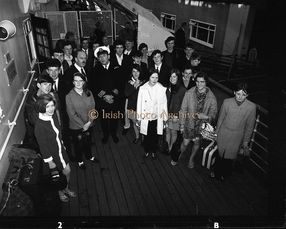 """Gael Linn Debating Competition Winners.<br /> 1970.<br /> 27.05.1970.<br /> 05.27.1970.<br /> 27th May 1970.<br /> A group of children who had taken part in the Gael Linn, National Debating Competition headed to Wales where they were to attend the Eisteddfod Festival. They were aboard the """"Mail Boat"""" the M.V.Hibernia.<br /> <br /> Image shows Captain Cyril Jones welcoming the party of children aboard the MV Hibernia."""