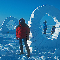 Photographer Gordon Wiltsie stands beside ice sculptures created by British artist Andy Goldsworthy, for whom Gordon was the polar guide.