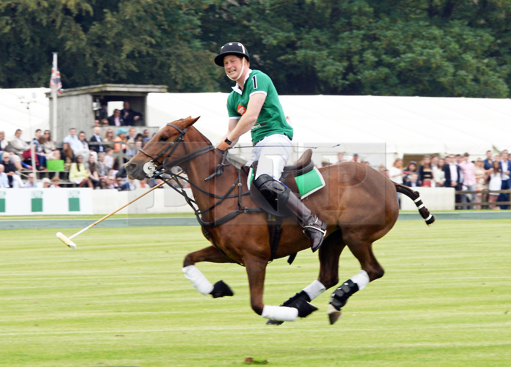 © Licensed to London News Pictures. 15/06/2014. London, UK Prince Harry, Maserati Jerudong Trophy Charity polo match, Cirencester Park Polo Club, 15 June 2014,. Photo credit : Mike Webster/PIQ/LNP