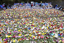 Volunteers relocate tributes, left for the victims of the Helicopter crash, to a new memorial site nearer to the crash site at the King Power Stadium, Leicester.