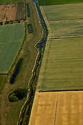 Nederland, Brabant, Gemeente Oss, 08-07-2010. De Groenendijk ten oosten van Haren. Tot aan de tweede wereldoorlog stroomde de Maas bij hoog water over de dijk bij Beers. Het overstromingsgebied werd de de Beerse Maas (Beersche Maas) genoemd, ook wel Beerse Overlaat. Om al te grote overlast te voorkomen was het overstromingsgebied door dwarsdijken in compartimenten verdeeld. De Groenendijk beschermde het achterliggende dorp. De bochten en wielen zijn sporen van vroegere doorbraken. .Groenendijk - Green dike. Until the second world war the Meuse flowed at high water over the dam at Beers. The floodplain was called the Beerse Maas or Beerse Spillway. The flood area was divided into compartments by transverse dikes, such as the Groenendijk, protecting the nearby village. The turns and small waters are traces of earlier breakthroughs..luchtfoto (toeslag), aerial photo (additional fee required).foto/photo Siebe Swart