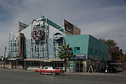 """.A car passes the old """"Live 33"""" in Juarez Mexico on Saturday, Oct. 10, 2009.."""