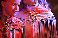 Two young girls at children's yoik singing concert during the Sami Easter Festival in Kautokeino, Finnmark, Norway.