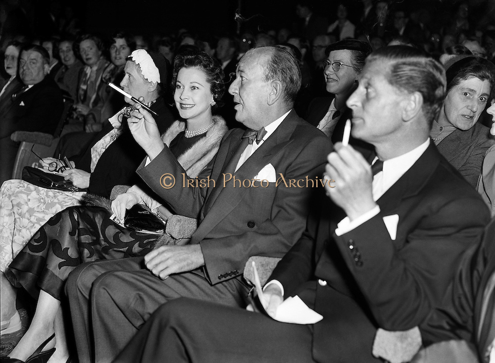 """Vivian Leigh with Noel Coward at Olympia Theatre.04/10/56..Vivien Leigh, Lady Olivier (05/11/1913 - 07/07/1967) was an English actress. She won the Best Actress Academy Award for her portrayal of Blanche DuBois in A Streetcar Named Desire (1951), a role she also played on stage in London's West End, as well as for her portrayal of the southern belle Scarlett O'Hara, alongside Clark Gable, in the epic American Civil War drama Gone with the Wind..She was a prolific stage performer, frequently in collaboration with her then-husband, Laurence Olivier, who directed her in several of her roles. During her 30-year stage career, she played roles ranging from the heroines of Noël Coward and George Bernard Shaw comedies to classic Shakespearean characters such as Ophelia, Cleopatra, Juliet and Lady Macbeth..Lauded for her beauty, Leigh felt that it sometimes prevented her from being taken seriously as an actress. However, ill health proved to be her greatest obstacle. For much of her adult life Leigh suffered from bipolar disorder. She earned a reputation for being difficult to work with, and her career suffered periods of inactivity. She also suffered recurrent bouts of chronic tuberculosis, first diagnosed in the mid-1940s. Leigh and Olivier divorced in 1960, and she worked sporadically in film and theatre until her death from tuberculosis in 1967..Sir Noël Peirce Coward (16/12/1899 - 26/03/) was an English playwright, composer, director, actor and singer, known for his wit, flamboyance, and what Time magazine called """"a sense of personal style, a combination of cheek and chic, pose and poise""""..Born in Teddington, a suburb of London, Coward attended a dance academy in London as a child, making his professional stage début at the age of eleven. As a teenager he was introduced into the high society in which most of his plays would be set. Coward achieved enduring success as a playwright, publishing more than 50 plays from his teens onwards. Many of his works, such as"""