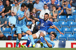 Coventry City's Michael Doyle (left) and Peter Vincenti battle with Chesterfield's Robbie Weir