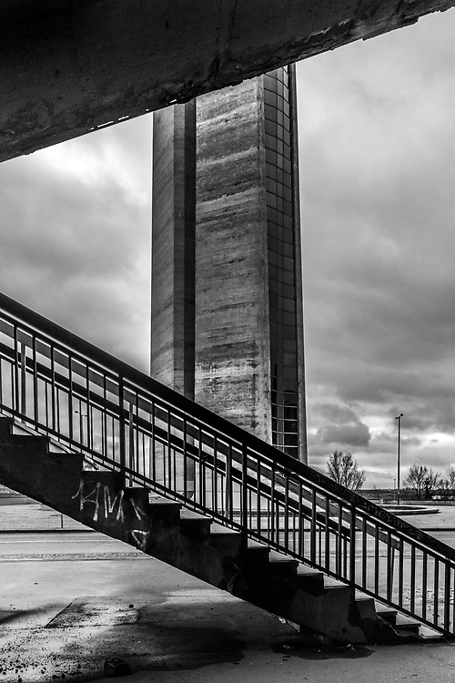 """Strahov Stadium. Prague, Czech Republic Prague, Czech Republic. December 2018.<br /> The abandoned Strahov Stadium lies in a state of decay. Construction began in 1926 based on the plans of architect Alois Dryák but its wooden construction was quickly replaced by concrete grandstands in 1932. <br /> Under the communist regime it was used to display massive synchronised gymnastic events known as """"Spartakiads"""". <br /> The Stadium is the biggest of its kind - covering an area of eight football pitches."""