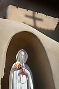 """Stature of Our Lady of Guadalupe at Santuario de Guadalupe church, Santa Fe, New Mexico The church is the oldest shrine to Our Lady of Guadalupe in the United States.   The city of """"holy faith"""" contains many reminders of its Spanish Catholic roots."""