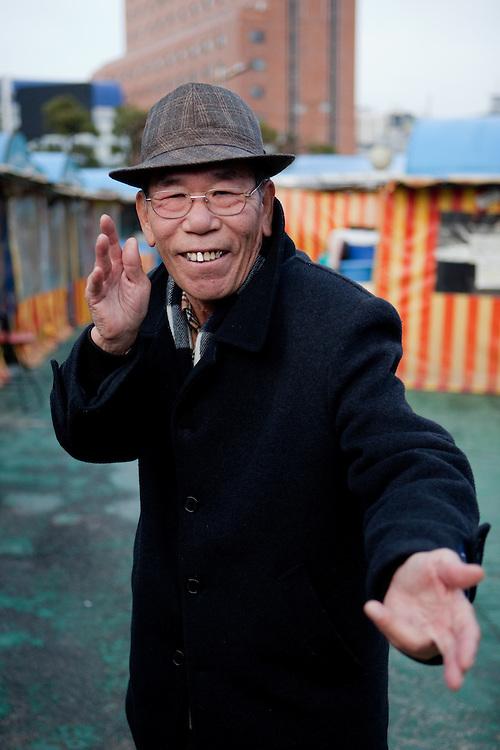 A pensioner spending his free time close to Haeundae beach. Busan, South Korea, Republic of Korea, KOR, 13th of February 2010.