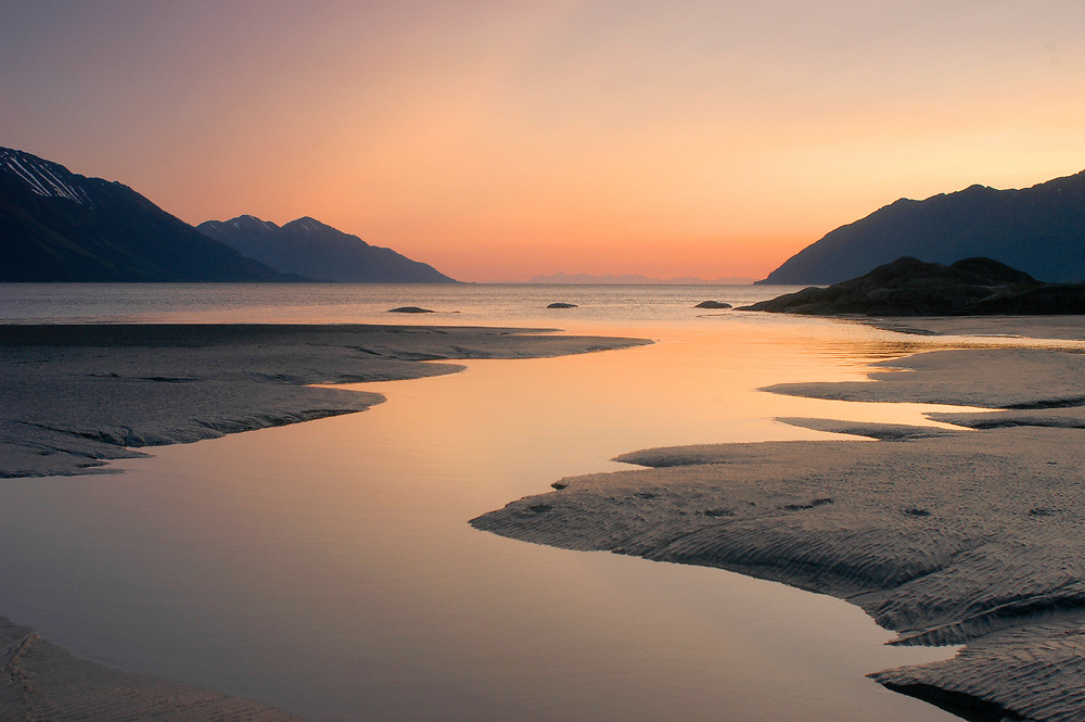 Alaska . Turnagain Arm . Chugach Mountains.Bird Point . Sunset along the tidal mud flats looking towards the Alaska Range .
