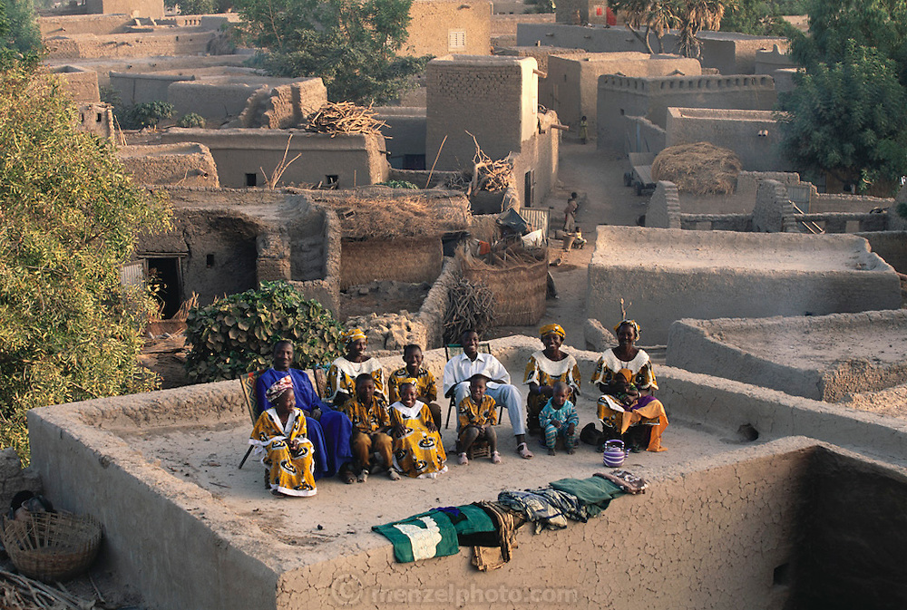 From coverage of revisit to Material World Project family in Mali, 2001. The Natomo family, with the few new possessions they have acquired since the shooting of the photograph of the family with all of its possessions for the 1994 book Material World: A Global Family Portrait.