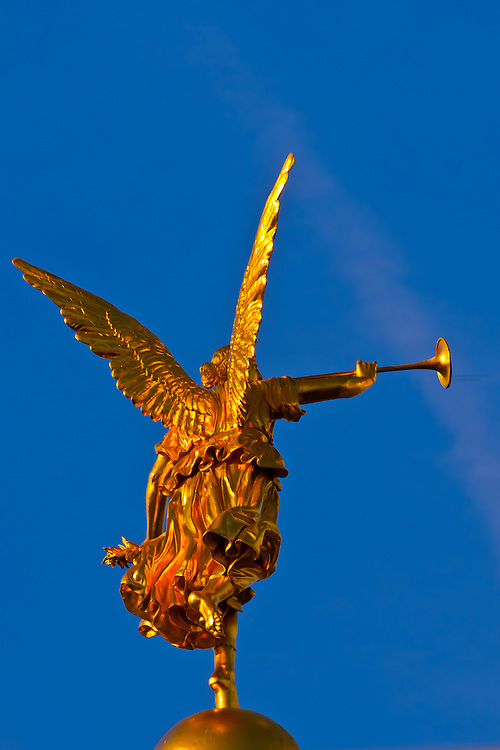 """Statue of an angel holding the """"Trumpet of Fame"""" atop the Kunstakademie (Art Academy), Dresden, Saxony, Germany"""