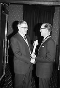 "14/02/1963<br /> 02/14/1963<br /> 14 February 1963<br /> Annual Dinner of the Irish Institute of Secretaries at Jury's Hotel, Dublin.  Mr George Ivan Morris (left), Editor of Irish Accountant and Secretary, presented with his Certificate of Membership for his interest he had ""shown in Institute activities and the generous space he has always allotted to Institute affairs. Mr Morris is the first person to receive Honorary Fellowship"". Making the presentation is Michael A. Purcell, President of the Institute."