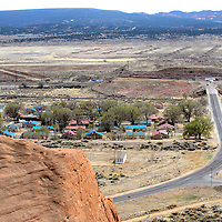 042413  Adron Gardner/Independent<br /> <br /> Churchrock is viewed from a cliffside Wednesday. Before this housing development was built, more than 50 families living in Churchrock were displaced after the Navajo Housing Authority demolished their houses and built a new development.  Albert Shirley, the former president of the Iyanbito Chapter, used to live there, said the displaced families were never compensated