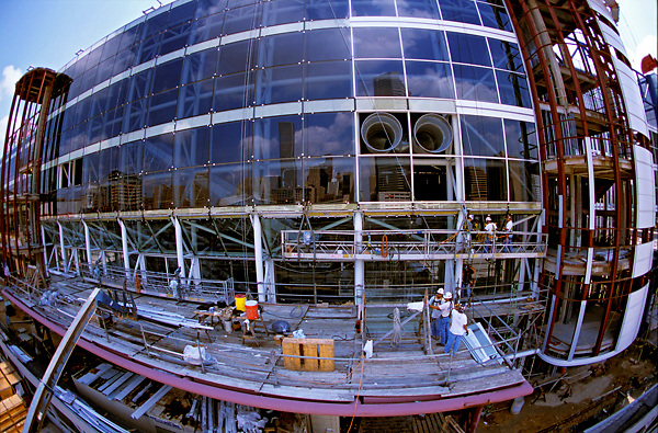 Stock photo of men on scaffolding working on the George R. Brown Convention Center in downtown Houston Texas