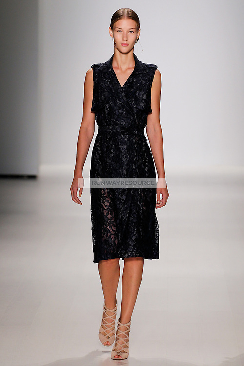 A model walks the runway wearing Tadashi Shoji Spring 2015 during Mecedes-Benz Fashion Week in New York on September 4th, 2014