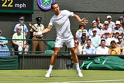 © Licensed to London News Pictures. 01/07/2019. London, UK. Philipp Kohlschreiber of Germany plays Novak Djokovic of Serbia in the 1st round mens singles mens singles draw of the Wimbledon Tennis Championships 201 on Day 1 held at the All England Lawn Tennis and Croquet Club. Photo credit: Ray Tang/LNP