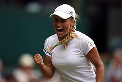 Yulia Putintseva celebrates winning the first set against Naomi Osaka on day one of the Wimbledon Championships at the All England Lawn Tennis and Croquet Club, Wimbledon.