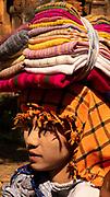 Woman selling fabric in the Shwe Inn Dain Village, Inle Lake, Myanmar