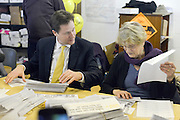 © Licensed to London News Pictures. 27/02/2013. Eastleigh, UK. Nick Clegg helps pack campaign leaflets. Leader of the Liberal Democrats and Deputy Prime minister Nick Clegg and Liberal Democrat Parliamentary Candidate for Eastleigh, Mike Thornton at the Liberal Democrat campaign headquarters in Eastleigh today 27th February 2013. Polling takes place across the borough tomorrow.  Photo credit : Stephen Simpson/LNP