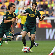 Diego Valeri, (centre), and Maximiliano Urruti, (left), Portland Timbers, in action during the New York Red Bulls Vs Portland Timbers, Major League Soccer regular season match at Red Bull Arena, Harrison, New Jersey. USA. 24th May 2014. Photo Tim Clayton